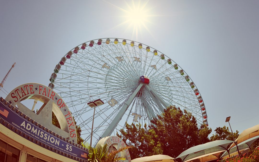 Photo showing a ferris wheel and admissions kiosk